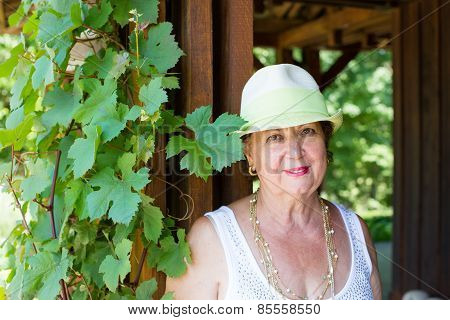 Stylish Modern Senior Lady In A Trendy Hat