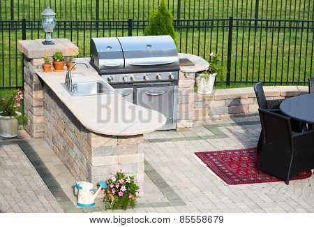 Stylish Outdoor Kitchen On A Brick Patio