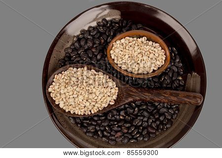 Millets  And Black Bean In Black Bowl On Gray Background