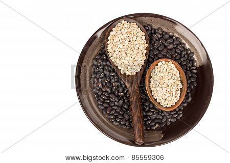 Millets  And Black Bean In Black Bowl On White Background