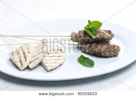 mutton kebab with mint and pita bread