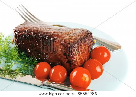 served beef meat chunk and tomatoes on blue