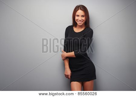 Beautiful mixed race woman on grey background