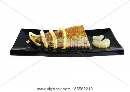 roast tuna served on black ceramic plate