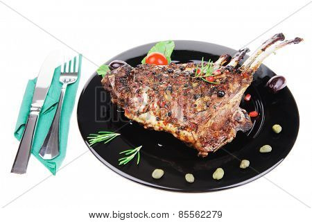 ribs rack served over black plate isolated on white