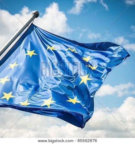 EU flag against blue sky