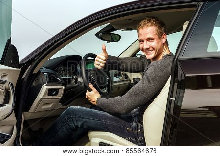 Attractive Young Fashion Man Showing The Thumbs Up Gesture