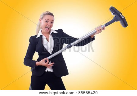 Businesswoman with vacuum cleaner on white
