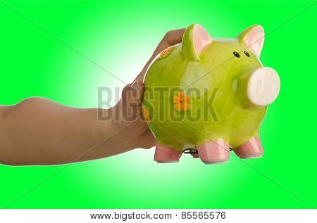 Hand with piggybank on white background
