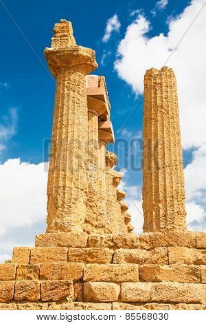 Pillars of Ercole temple in the Valley of the Temples, Agrigento, Sicily island, Italy