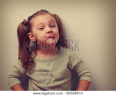 Fun Smiling Girl Grimacing Showing The Tongue. Closeup Vintage