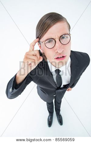 Thoughtful geeky businessman on white background