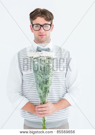 Geeky hipster offering bunch of flowers on white background