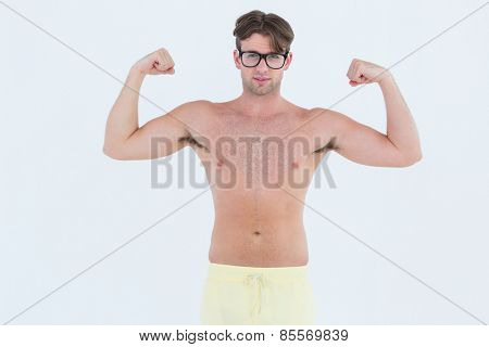 Geeky hipster posing topless on white background
