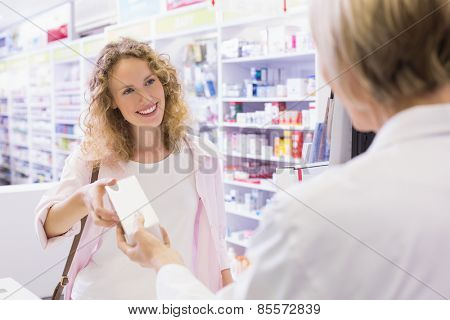 Costumer taking medicine box at pharmacy