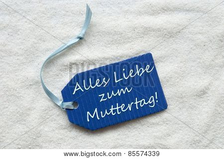 Muttertag Means Happy Mothers Day On Blue Label Sand Background