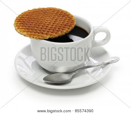 dutch stroopwafel, caramel waffle and coffee isolated on white background