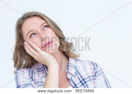 Pretty day dreaming hipster on white background
