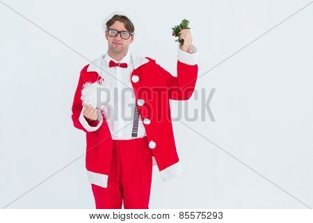 Geeky hipster in santa costume beard and mistletoe on white background