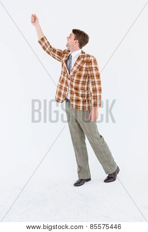 Geeky hipster with hand up on white background