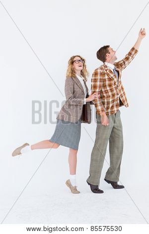 Happy geeky hipster couple on white background