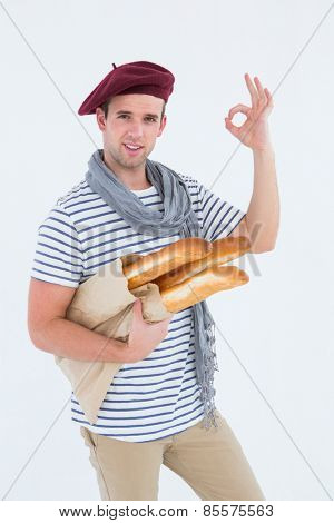 French guy with beret holding baguettes on white background
