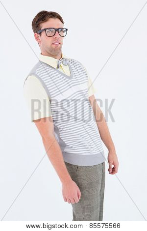 Geeky hipster pulling a silly face on white background