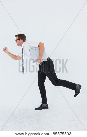 Geeky businessman running late on white background