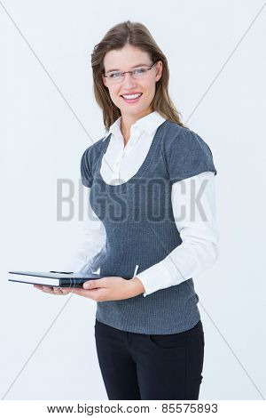 Happy woman holding diary on white background