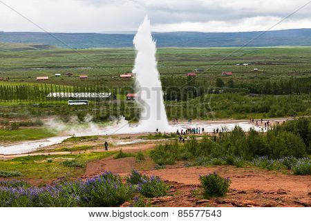 Tourists Are Looking Eruption Of Strokkur Geyser, Iceland