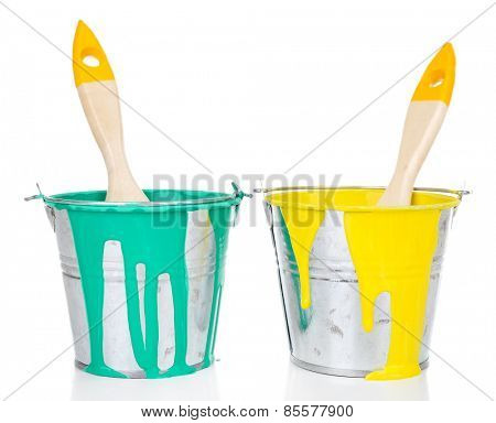 Buckets of paints with brushes isolated on white