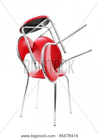 Stack of red chairs isolated on white