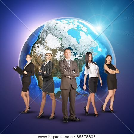 Business women and men in suits, smiling. Against background of globe earth