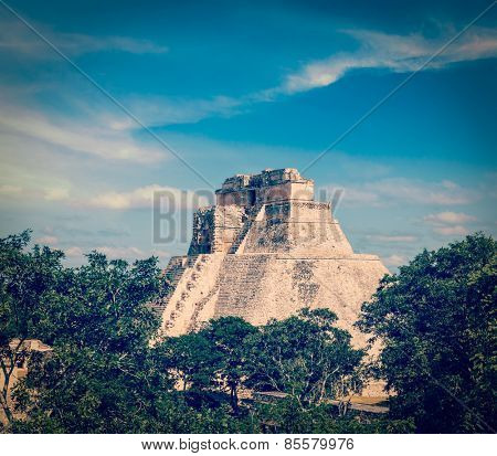 Vintage retro effect filtered hipster style image of ancient mayan pyramid (Pyramid of the Magician) in Uxmal, Merida, Yucatan, Mexico