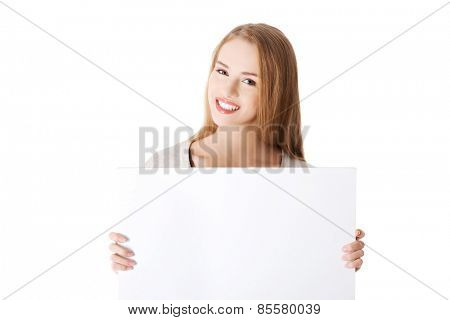Portait of happy woman holding an empty baner.