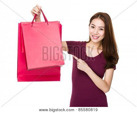 Happy shopping woman smiling