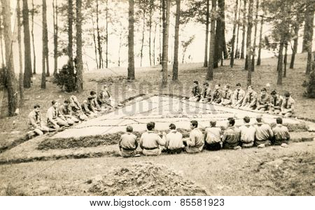 SZCZAWNICA, POLAND, CIRCA 1950's: Vintage photo of group of scouts in forest