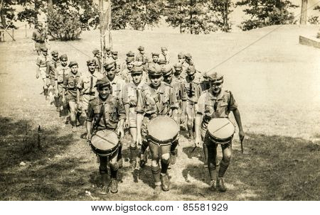 SZCZAWNICA, POLAND, CIRCA 1950's: Vintage photo of group of scouts marching outdoor and playing drums