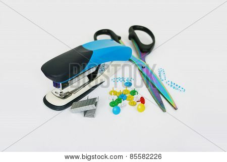 Stapler, Scissors, Thumbtacks, Paper Clips On A Light Background