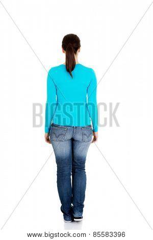 Full length woman standing back.