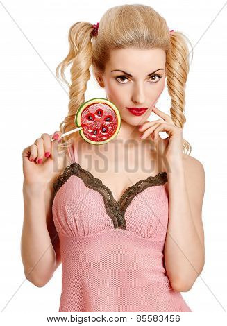 Glamorous girl with  big lollipop on white background