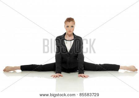 Strict businesswoman posing doing gymnastic split