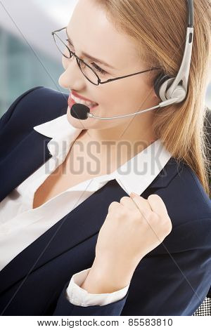 Beautiful caucasian business woman at call center