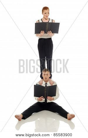 Emotional businessmen-acrobats posing at camera