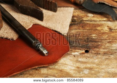 Leather and craft tools on table close up