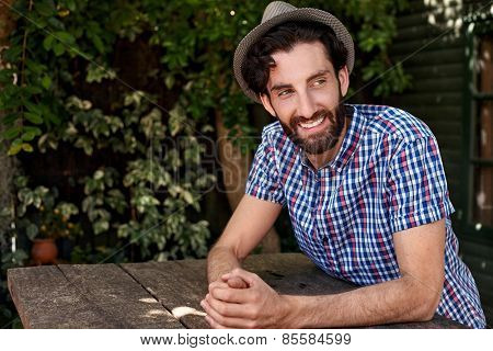 portrait of young man relaxing outdoors at home