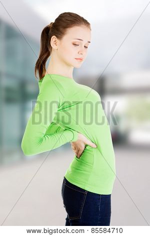Young woman with huge backache.