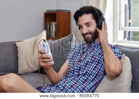 mobile cellphone man listening music sofa couch at home living room