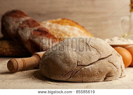 Making bread on table and wooden background