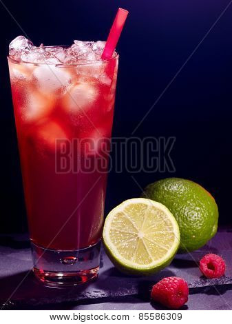 Red raspberry drink  with green lime on black background. Cocktail card 11.